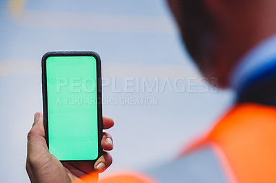 Buy stock photo Closeup of an unrecognizable engineer browsing on his cellphone inside of a workshop