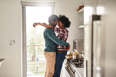 Buy stock photo Cropped shot of an affectionate couple spending quality time together at home