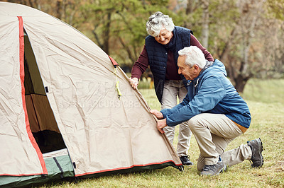 Buy stock photo Shot of a senior person camping in the wilderness