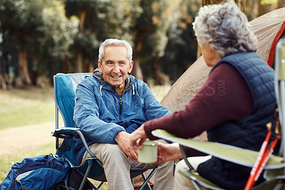 Buy stock photo Shot of a senior man camping with his wife in the wilderness