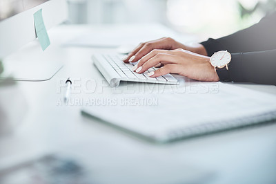 Buy stock photo Closeup shot of an unrecognisable businesswoman working on a computer in an office