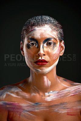 Buy stock photo Studio shot of a beautiful young woman wearing body paint against a black background