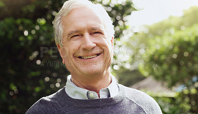 Buy stock photo Portrait of a cheerful senior man enjoying himself while spending the day outdoors
