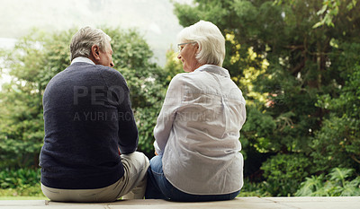 Buy stock photo Rearview shot of a happy senior couple bonding and spending time together outdoors