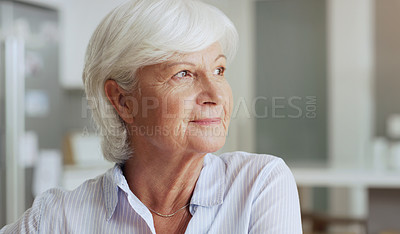 Buy stock photo Shot of a senior woman looking thoughtful while relaxing at home
