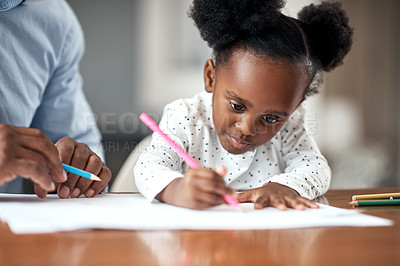 Buy stock photo Cropped shot of a young girl writing with coloring pencils at home