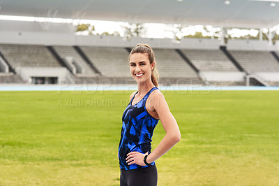 Buy stock photo Cropped portrait of an attractive young female athlete standing with her hands on her hips at the track