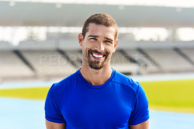 Buy stock photo Cropped portrait of a handsome young male athlete standing outside at the track
