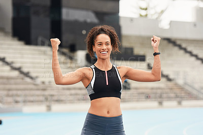 Buy stock photo Cropped shot of an attractive young female athlete celebrating while out on the track