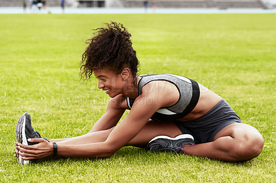 Buy stock photo Full length shot of an attractive young female athlete warming up at the track