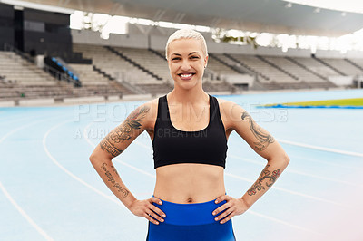 Buy stock photo Cropped portrait of an attractive young female athlete standing with her hands on her hips out on the track
