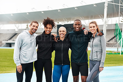 Buy stock photo Cropped portrait of a diverse group of athletes standing together and smiling after an outdoor team training session