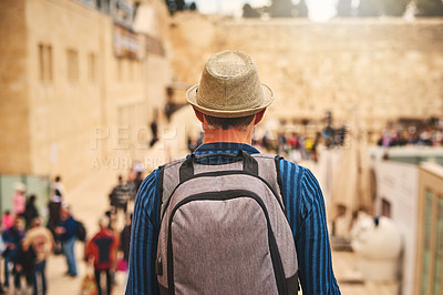 Buy stock photo Rearview shot of a young man exploring the city of Jerusalem