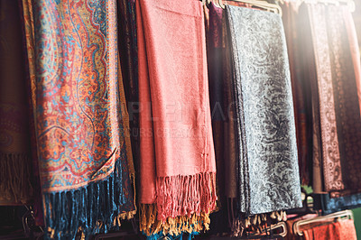 Buy stock photo Shot of various scarves at a market stall