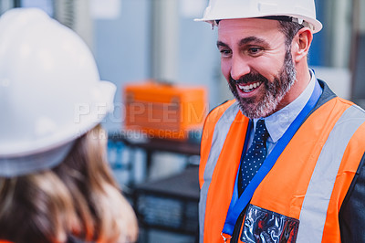 Buy stock photo Over the shoulder shot of two confident engineers having a discussion together inside of a workshop
