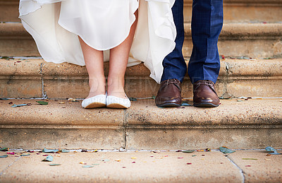 Buy stock photo Cropped shot of a couple standing on steps after their wedding ceremony