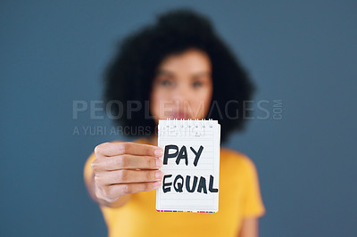 Buy stock photo Studio shot of an unrecognizable young woman holding up a placard with the words