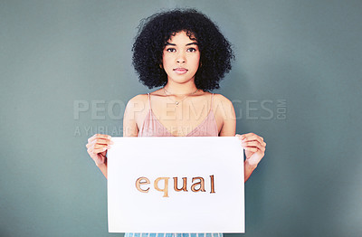 Buy stock photo Portrait of a beautiful young woman holding up a placard written