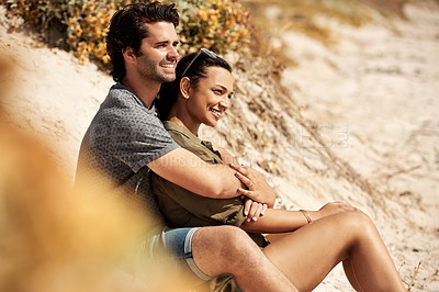Buy stock photo Shot of a happy young couple having a relaxing day together at the beach