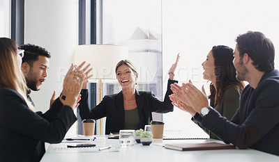 Buy stock photo Shot of a group of businesspeople applauding during a meeting in a boardroom