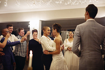 Buy stock photo Cropped shot of an affectionate young lesbian couple slow dancing while their guests hold sparklers around them on their wedding day