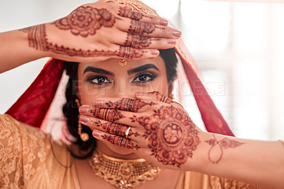 Buy stock photo Portrait of a beautiful young woman covering her face with her hands on her wedding day