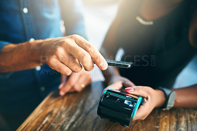 Buy stock photo Cropped shot of an unrecognizable businessman scanning his cellphone to pay for his bill in a cafe