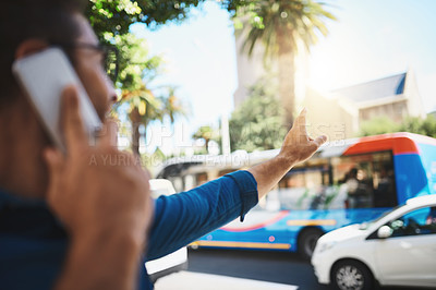 Buy stock photo Shot of a man trying to catch a cab in the city