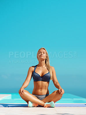 Buy stock photo Full length shot of a beautiful young woman meditating while exercising outdoors
