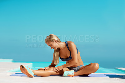 Buy stock photo Full length shot of a beautiful young woman warming up before starting her workout