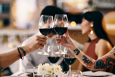 Buy stock photo Cropped shot of an unrecognizable couple making a celebratory toast while sitting in a restaurant