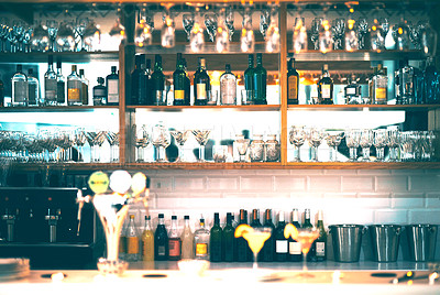 Buy stock photo Shot of an immaculate bar with many bottles and glasses with no people