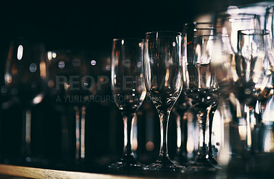 Buy stock photo Shot of empty glasses on a countertop in a nightclub