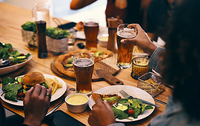 Buy stock photo Cropped shot of a group of unrecognizable people enjoying food and drinks together