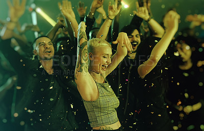 Buy stock photo Cropped shot of an attractive young woman dancing with her friends at a party in a nightclub