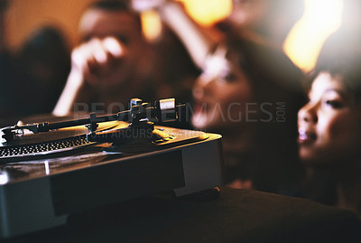 Buy stock photo Cropped shot of unrecognizable people standing next to a turntable in a nightclub