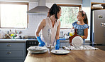 Mother and daughter both love a clean kitchen
