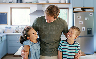 Buy stock photo Cropped shot of an affectionate young father spending time with his two kids in the kitchen at home