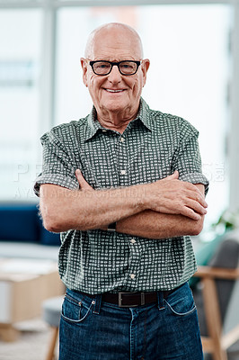 Buy stock photo Portrait of a cheerful senior creative businessman posing with his arms folded inside his office