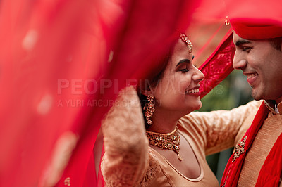Buy stock photo Cropped shot of a young hindu couple on their wedding day