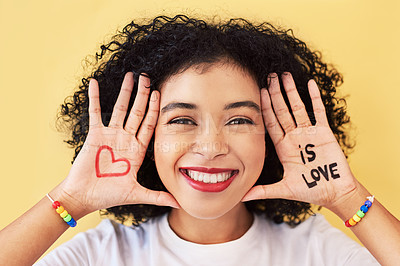 Buy stock photo Studio portrait of an attractive young woman posing with love symbols and words painted on her palms
