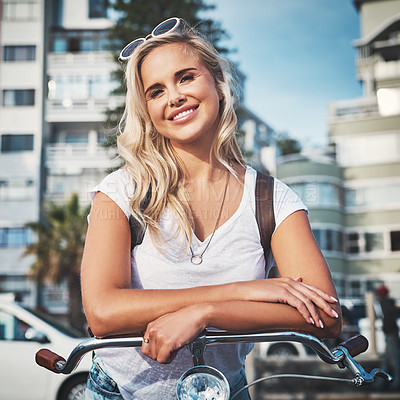 Buy stock photo Cropped shot of a beautiful young woman out with her bicycle