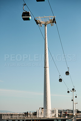 Buy stock photo Cropped shot of cable way transport and cable cars during the day in Portugal