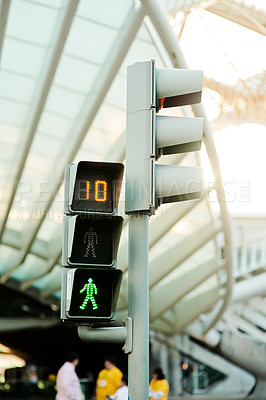 Buy stock photo Cropped shot of traffic lights and street signs in a busy Portuguese city during the day