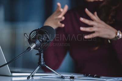 Buy stock photo Cropped shot of an unrecognizable businesswoman sitting alone and making hand gestures during a broadcasting in her office
