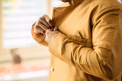 Buy stock photo Cropped shot of a man getting dressed on his wedding day