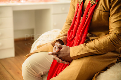 Buy stock photo Cropped shot of a man sitting on a bed and waiting in anticipation on his wedding day