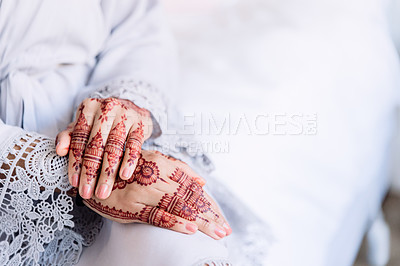 Buy stock photo Cropped shot of an unrecognizable woman with mehendi painted on her hands on her wedding day