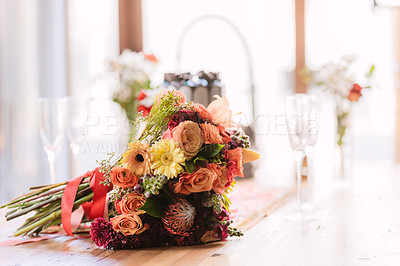 Buy stock photo Shot of a bunch of flowers on a table at a wedding reception