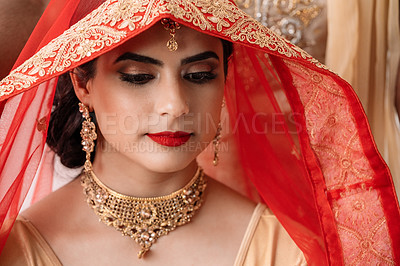 Buy stock photo Shot of a young woman covering her hair with a veil on her wedding day